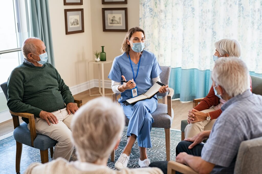 Self help therapy group meeting in nursing home during covid